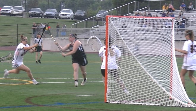 Kennard-Dale's Maddie Day pulls in a pass from a teammate before firing home a shot and score against Hershey in a District 3 Class 2A lacrosse semifinal Tuesday, May 22, 2018.