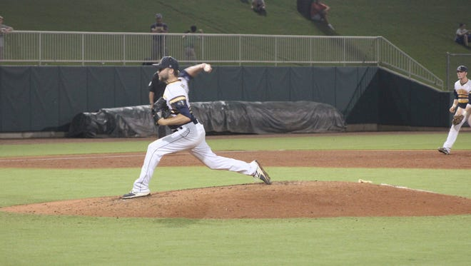 Augustana's David Flattery delivers a pitch in Sunday night's win