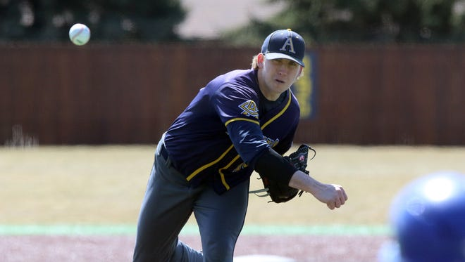 Tyler Mitzel, pictured here pitching earlier this season, improved to 12-0 by defeating Southern New Hampshire Thursday in the College World Series