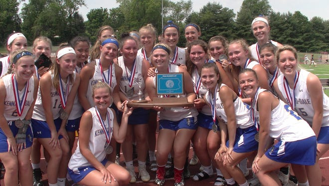 Members of the Kennard-Dale girls' lacrosse team pose with the PIAA Class 2A second-place trophy after losing to Villa Maria, 17-5, in the title game on Saturday at West Chester East High School.