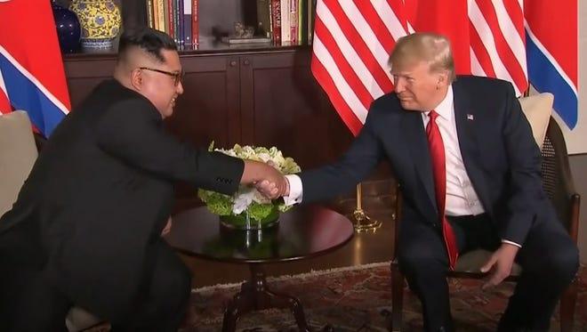 North Korean leader Kim Jong Un and U.S. President Donald Trump shake hands in Singapore.