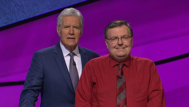 Scott McFadden (right) poses with Alex Trebek, host of Jeopardy!