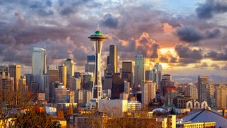 12. Seattle: Seattle hotels are among the cheapest, and airfare falls in the middle compared to the other vacation cities. But food and drink can be expensive, with the average three-course dinner for two costing $60, and domestic beers going for $5.50 on average. It's the most expensive city for foodies overall, a separate GOBankingRates study found.   You can keep spending in check, though, by taking advantage of the free things to do there. For example, enjoy samples from vendors at Pike Place Market, one of the oldest continuously operated farmers markets and home to the original Starbucks coffee store.