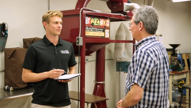 City of Ventura Green Business Program Coordinator Lars Davenport talks to Gregg Butler of Brazuka Coffee Roasters about green business practices.