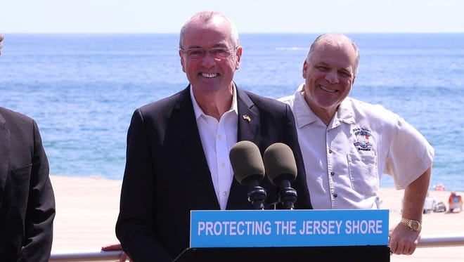 Gov. Phil Murphy signs legislation banning smoking at public beaches and parks during a visit to the Long Branch boardwalk.Long Branch, NJFriday, July 20, 2018@dhoodhood