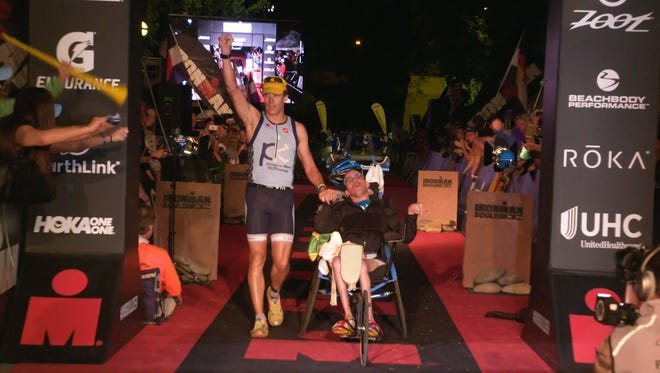 Brothers Kyle and Brent cross the finish line and earn the title of IRONMAN.