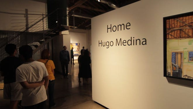 """The entrance of Hugo Medina's exhibit, """"Home,"""" at MonOrchid Gallery in Phoenix."""