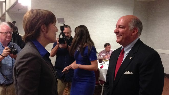 Congressman Steve Southerland, right,and challenger Gwen Graham meet before a debate at the Capital Tiger Bay Club Wednesday.
