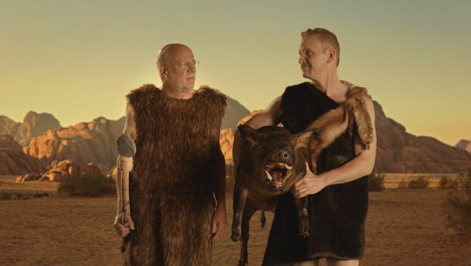 Morgan Spurlock (r) and John Steele Gordon are in character for the short film 'Cave-O-Nomics.'