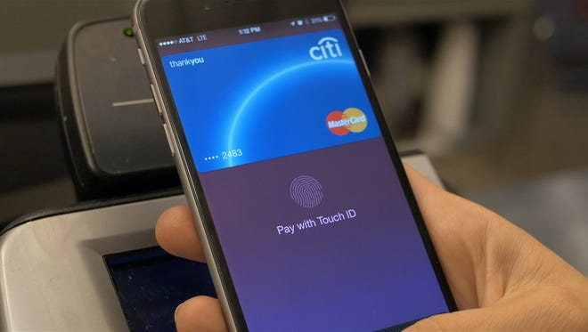 An Apple iPhone 6 being used with Apple Pay.