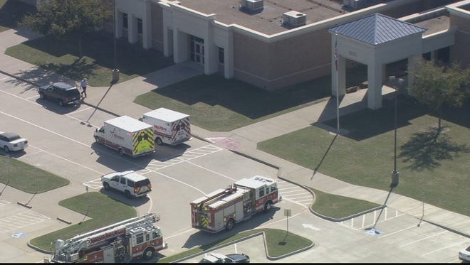 Paramedics responded to Highland Middle School in Saginaw, Texas, on Oct. 21, 2014, after 20 students were stung by bees during an outdoor physical education class.