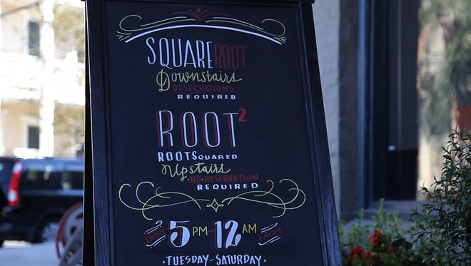 A sign for Square Root, Chef Phillip Lopez's tasting-menu restaurant in New Orleans' Lower Garden District.