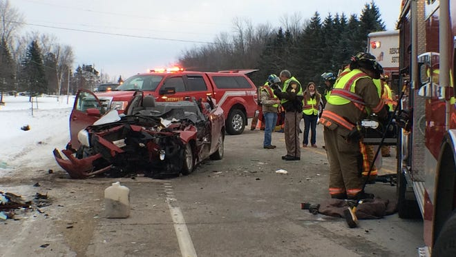 A Toyota Corolla that crashed into a cement truck early Thursday is seen after first responders used the Jaws of Life to extract the 37-year-old driver. The Green Bay man suffered possible life-threatening injuries, but is expected to survive.
