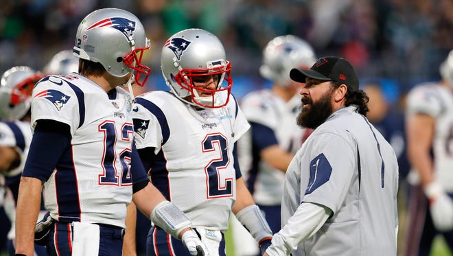 Patriots quarterbacks Tom Brady (12) and Brian Hoyer, and defensive coordinator Matt Patricia talk during warmups prior to Super Bowl LII against the Eagles at U.S. Bank Stadium on Sunday, Feb. 4, 2018 in Minneapolis.