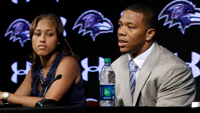 FILE - In this May 23, 2014, file photo, Baltimore Ravens running back Ray Rice, right, speaks alongside his wife, Janay, during a news conference at the team's practice facility in Owings Mills, Md. A new video that appears to show Ray Rice striking then-fiance Janay Palmer in an elevator last February has been released on a website. (AP Photo/Patrick Semansky, File)