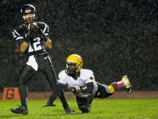 South Western's Brady Thayer, left, catches a pass to score a touchdown against Red Lion's Nate Orji during the second half of Friday's game at South Western. The 38-yard pass was Thayer's only catch of the day, and it helped the Mustangs earned a 20-0 homecoming victory in 2014. (Chris Dunn -- GameTimePA.com)