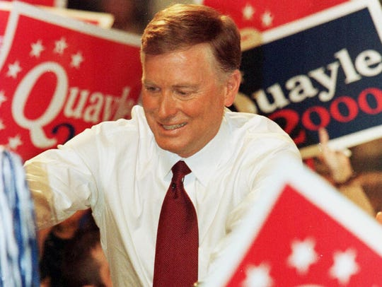Former Vice President Dan Quayle shakes hands with