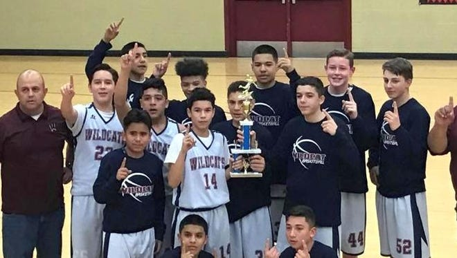 Red Mountain Middle School eighth grade basketball teams turned highly sucessful seasons on the hardwood. The Wildcat eighth grade boys basketball team went undefeated in the regular season and captured the district championship.The team is coach by Gabe Arellano and Angel Caballero. Players are: Jordan Caballero, Jonathan Caballero, Nathan Arroyos, Drew Iglesias, Christian Pacheco, Sebastian Villeszcas, Adan Lozano, Silas Turner, Chris Landeros, Jacob Cabrera, Javier Valdez, Joel Madrid, and Carter Williams. Not pictured is Ethan Castrillos.  The RMMS Lady Cat eight graders finished 14-3 during the regular season and placed second in the post-season tournament at La Plata Junior High in Silver City. The Lady Cats beat Snell and Soccoro to get to the championship against La Plata, but lost 25-23. The Lady Cats are: Aileen Jacquez, Alissa Cordova, Katelyn Morgan, Jenae Jasso, Pilar Garcia, Kaydance Chavez, Rachel Sims, Karlie Hudson, Poppy Schultz, Jazmine Lopez, Amanda Saenz and Coach Carlos Jaquez.