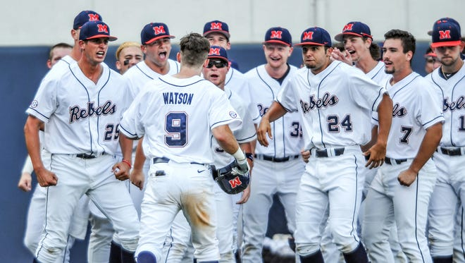 Left fielder Kyle Watson (9) is congratulated by his teammates following his solo home run against Tulane in an NCAA regional college baseball tournament game at Oxford-University Stadium in Oxford, Miss., on Saturday, June 4, 2016. (Bruce Newman /The Oxford Eagle via AP)  NO SALES; MANDATORY CREDIT