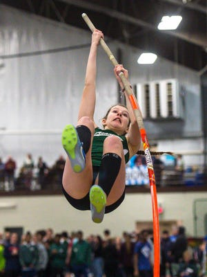 St. Johnsbury Academy's Hannah Wescott competes in the pole vault during the high school indoor track and field state championships in Northfield on Saturday, February 4, 2017.