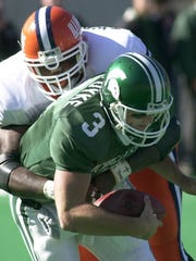 MSU quarterback Ryan Van Dyke is sacked by Illinois defensive end Terrell Washington.