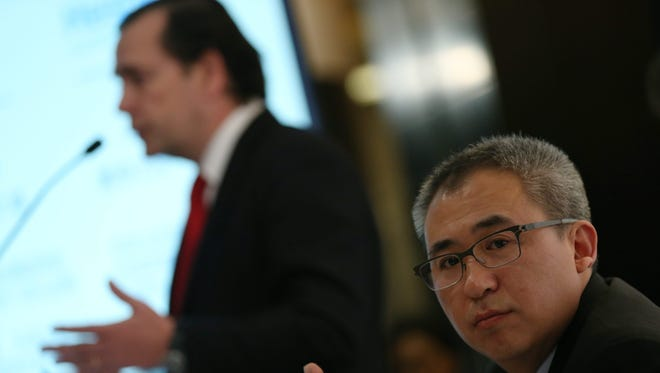China's HNA Hospitality group Chairman Bai Haibo (right) listens as Spanish hotel group NH Hotel CEO Federico Gonzalez Tejera speaks during a press conference before their Chinese brand launch event at Tangla Hotel in Beijing, China, March 30, 2016.