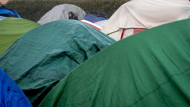 A tent has been erected along Southwood Lane near Coburg Road in an area where homeless people frequently camp. To have a wider scope of homelessness in the area, local government and its nonprofit partners are using the Homeless By-Name List, which tracks people who are receiving services and who are unhoused from a number of local agencies monthly. [Andy Nelson/The Register-Guard] - registerguard.com