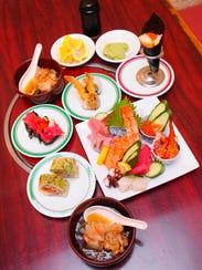 Sashimi, sushi dishes and agedashi tofu prepared at