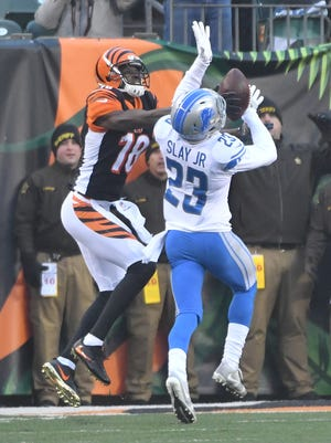Bengals' A.J. Green had a good day against the Lions' Darius Slay Sunday.