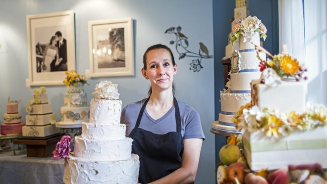 Tiffany Good stands in the display room at Tiffany Baking Co., the wedding cake and dessert business she started about 10 years ago. 7/8/15