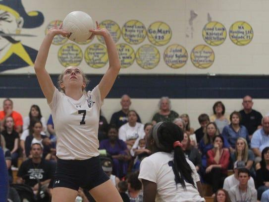 Sneads senior Alyssa Stagner sets a ball during a senior-night
