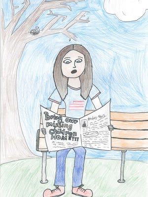 """IOWA WINNER: Kaitlyn K., student at Norway Elementary — """"I decided to do a woman reading a newspaper because a lot of people read newspapers and a lot of interesting information is on them. I thought it would be a good place to write 'Bring our missing children home.' """""""