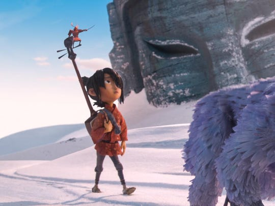 """Kubo, voiced by Art Parkinson (""""Game of Thrones""""), left, and Monkey, voiced by Charlize Theron, are seen in """"Kubo and the Two Strings."""""""