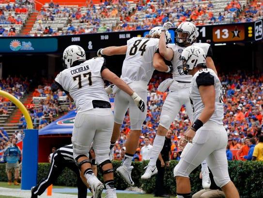 Vanderbilt wide receiver Caleb Scott (9) catches the