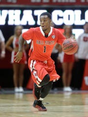 FILE -- Ball State's Zavier Turner (1) brings the ball up court in the first half during an NCAA college basketball game against Utah Friday, Nov. 14, 2014, in Salt Lake City.
