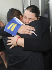 Kathleen Aguero, facing, embraces her partner, Loretta Pangelinan, on the steps of the U.S. District Court of Guam building in Anigua on June 5. The couple filed a lawsuit in April after they were denied the application for a marriage license at the Department of Public Health and Social Services, but on June 5, the couple won a ruling handed down by a federal judge, that declares a Guam law, that defines marriage as a union between couples of the opposite sex, to be unconstitutional.