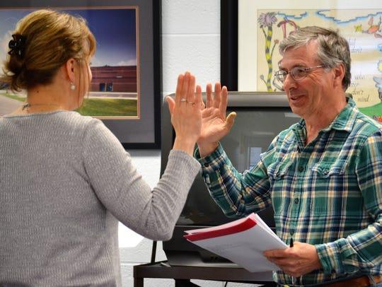 New Oconto School Board member Ron Richter is sworn