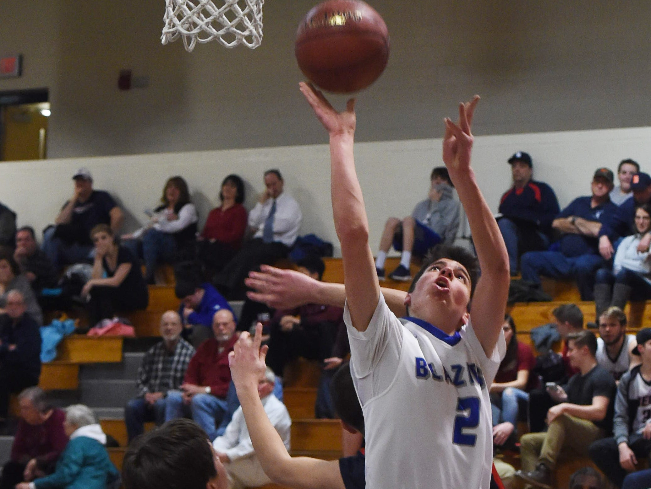 Millbrook High School's Colby Whalen takes a layup during the Section 9 Class C championship game against Tri-Valley at Mount Saint Mary College on March 3.