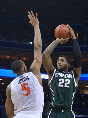 Branden Dawson puts in a basket over the top of Darion Atkins.
