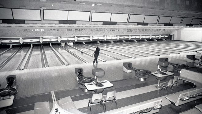 A lone bowler shoots at the pins at Buccaneer Bowl in January 1984. The bowling alley was closed in February 1984 and razed to make way for an H-E-B.