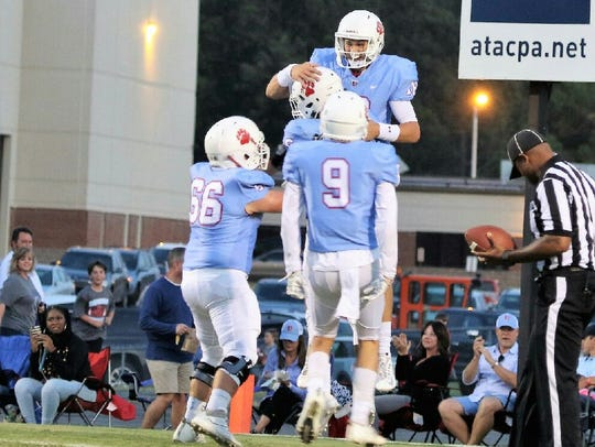 USJ's Jacob Buie celebrates after scoring a touchdown