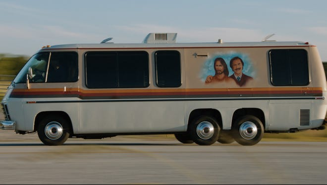 Jesus and Ron Burgundy share the side of this old RV
