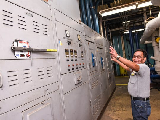 Electrician Supervisor Timoteo Ocampo points out the main electrical distribution panel still being utilized in the day-to-day operations at the Guam Memorial Hospital in this Jan. 30, 2018, file photo.