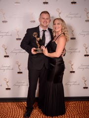 Matthew Apthorp, pictured with his wife Kimberly, won his fourth Emmy award for his work on an investigative series on a test for teachers in Florida.