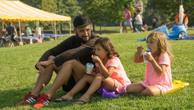 Michael Bellestri, with daughters Gianna Bellestri, 6 years old, and Mariella Bellestri, 5 yearss old, enjoy the evening at the Fly and Fry event in Heritage Park Tuesday. For more photos from the event, please see inside.