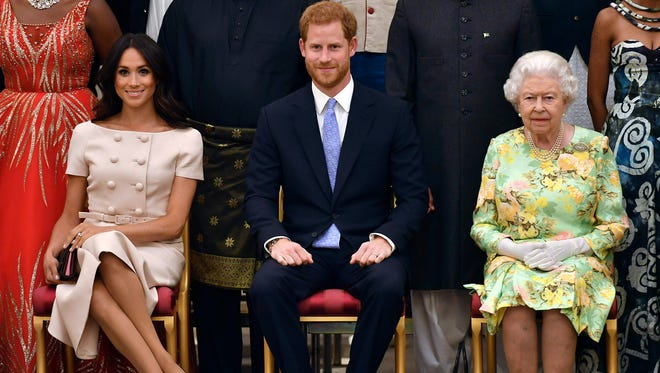 Duchess Meghan of Sussex once again joined Queen Elizabeth II for a public engagement, this time accompanied by new husband Prince Harry, when they all hosted a reception at Buckingham Palace for the Queen's Young Leaders Awards on June 26, 2018.