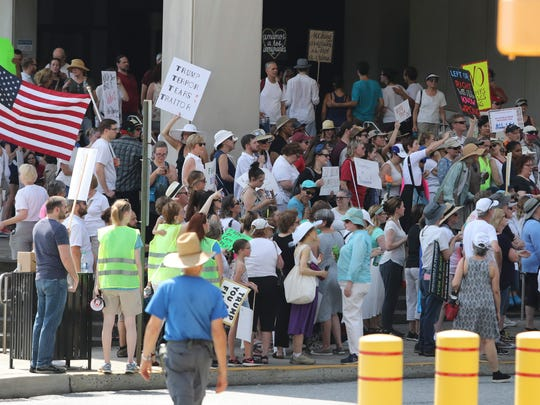 """Hundreds of protesters stand on the steps of the Carvel State Office Building in Wilmington to rally against the Trump administration's """"zero tolerance"""" immigration policy Saturday."""