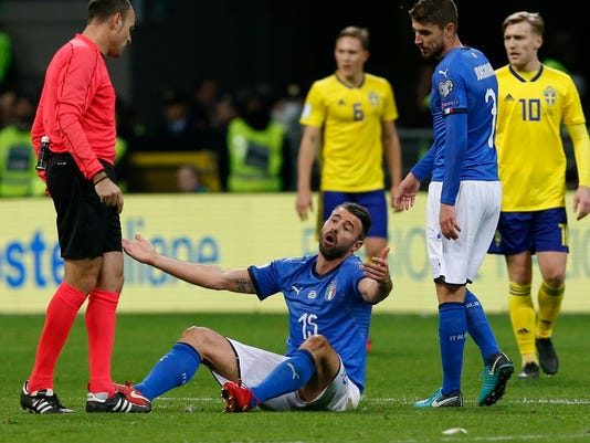 Italy's Andrea Barzagli reacts during the World Cup qualifying play-off second leg soccer match between Italy and Sweden, at the Milan San Siro stadium, Italy, Monday, Nov. 13, 2017. (AP Photo/Antonio Calanni)