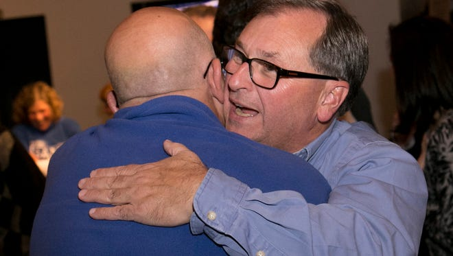 Steve Sheldon hugs Gary Bishop after both had won victories in their respective races at the Richland County Republican watch party at Buck's Bar & Grill in Lexington.