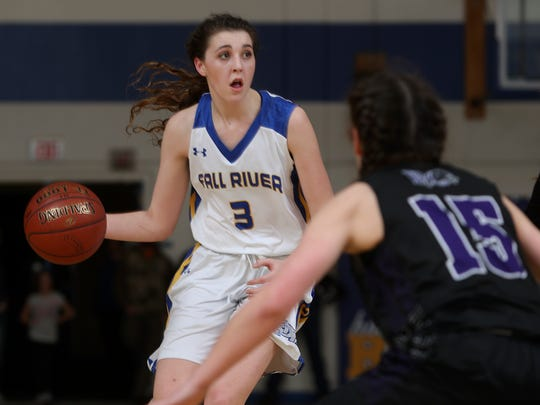 Fall River girls basketball team member Madison Corder looks to advance the ball during the Bulldogs' 50-49 win Tuesday night in Fall River Mills.